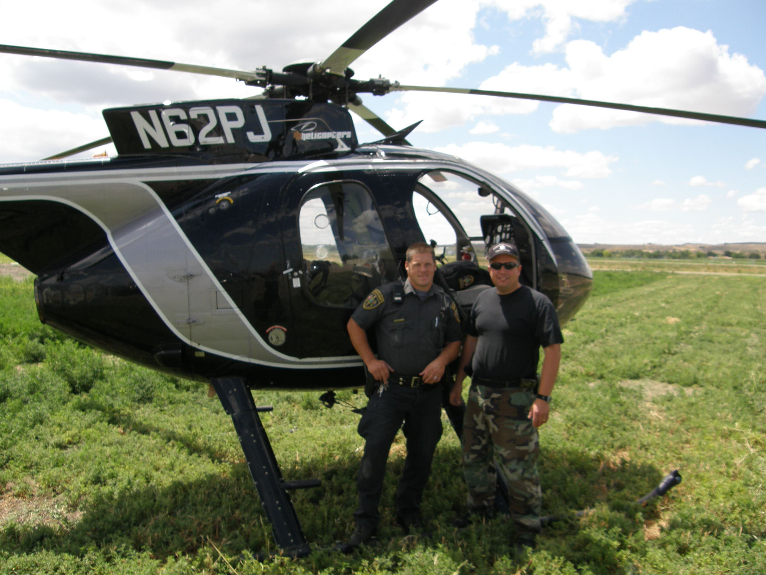 Two Men in Front of a Helicopter